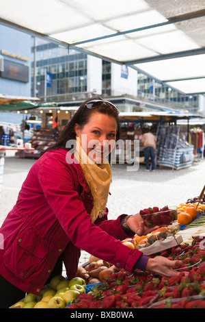 Young woman shopping in fruit market - Stock Photo