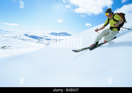 Man skiing in mountain scenery - Stock Photo