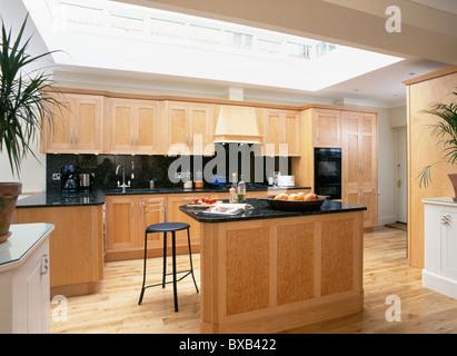 Black Granite Worktop On Island Unit In Modern Kitchen