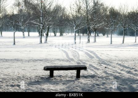 winter scene park bench england uk - Stock Photo