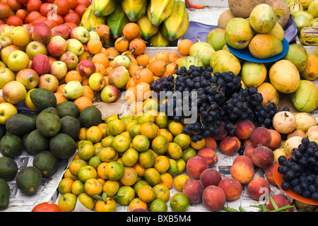 Assorted fruit in market stall - Stock Photo