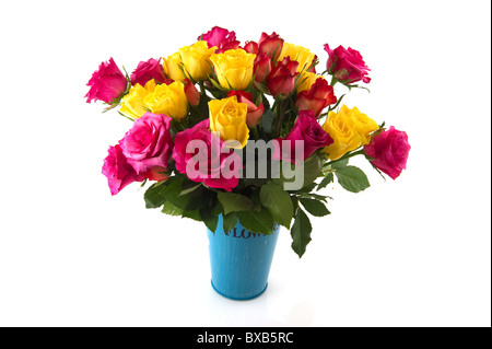 bouquet colorful roses in vase isolated over white - Stock Photo