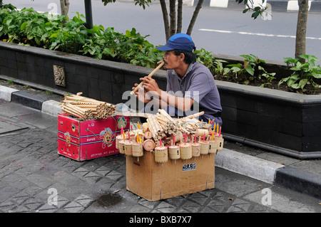 Street hawker in Yogyakarta, Central Java, Indonesia, Southeast Asia - Stock Photo