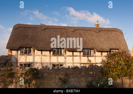 A converted thatched barn in the Cotswold village of Stanton, Gloucestershire, England - Stock Photo