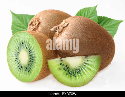 Kiwi with leaves on a white background - Stock Photo