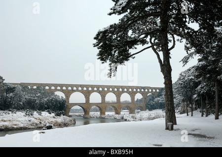 Pont du Gard Roman Aqueduct Under Snow, Remoulins, near Nimes, France - Stock Photo