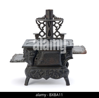 Old Miniature Stove isolated on a white background - Stock Photo