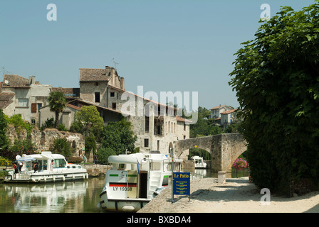 Pleasure boats on the river Baise at Nerac - Stock Photo