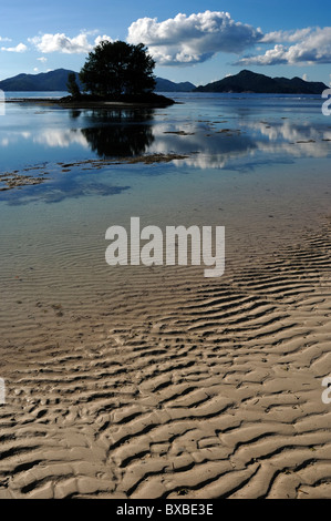 Late afternoon at Anse Source d'Argent beach on the south-west coast of La Digue island in the Seychelles - Stock Photo