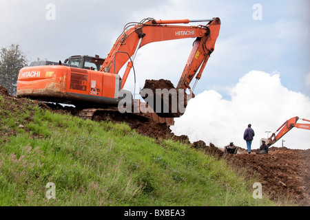Excavator or digger heavy equipment working on highway construction in Nairobi, Kenya - Stock Photo