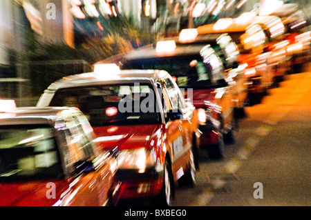 Queue of taxicabs waiting in line Changi airport terminal in Singapore southeast Asia - Stock Photo