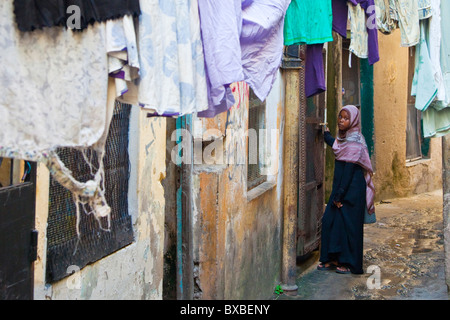 Narrow alleyway in the old town of Mombasa, Kenya - Stock Photo