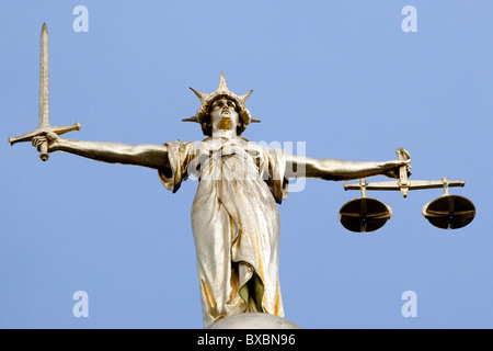 Statue of Lady Justice on the Old Bailey, Central Criminal Court in London, England, United Kingdom, Europe - Stock Photo