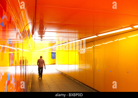 Man walking through an underpass in London, England, United Kingdom, Europe - Stock Photo