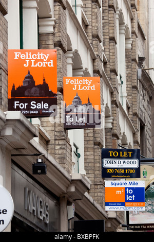 Signs, offices to let, offices for sale, financial district in London, England, United Kingdom, Europe - Stock Photo