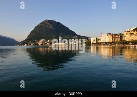 Lugano with San Salvatore mountain on Lago di Lugano, Lake Lugano, Canton of Ticino, Switzerland, Europe - Stock Photo