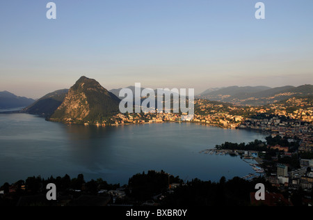 Lugano with San Salvatore mountain on Lago di Lugano, Lake Lugano, Canton of Ticino, Switzerland, Europe - Stock Photo