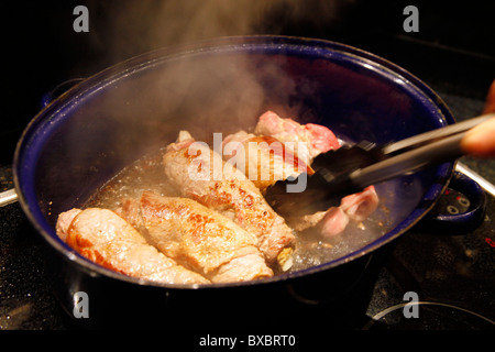 Beef roulades, fried in a roasting dish. - Stock Photo