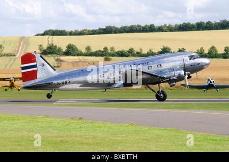Douglas C-53D Skytrooper ( DC-3A Dakota ) taking off at Duxford Airfield - Stock Photo