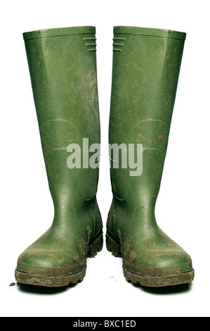 Wellington Boots Covered in Mud, Cut Out. - Stock Photo