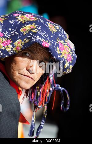 A ladakhi woman wearing traditional headdress - Stock Photo