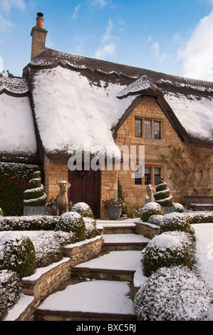 A Cotswolds cottage covered in snow. Chipping Campden. Gloucestershire. England. - Stock Photo