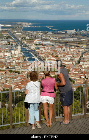 Tourists Admire the View over Sète and the City's Canals from the Mont St-Clair Viewpoint, Sète, France - Stock Photo