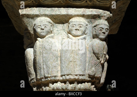 Carved Stone Monks on Capital of the Cloisters, Saint-Martin-du-Canigou Abbey or Monastery, Pyrenees, France - Stock Photo