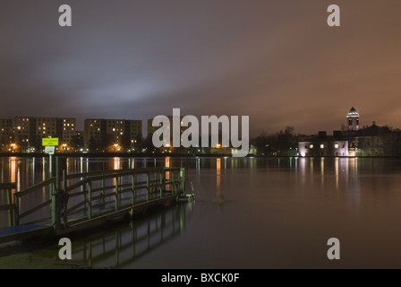 The winter-swimming quay in Tuira, Oulu, Finland, with science center Tietomaa and some apartment buildings in the - Stock Photo