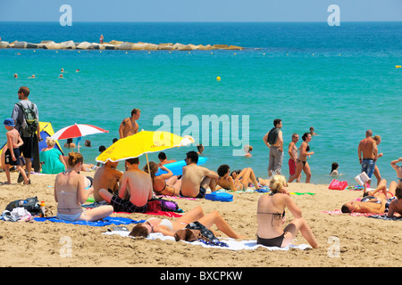 The Platja de Sant Sebastià beach in La Barceloneta, Barcelona, Spain. - Stock Photo