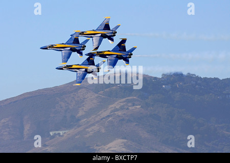 Blue Angel diamond formation in flight backed by the Marin Headlands. - Stock Photo