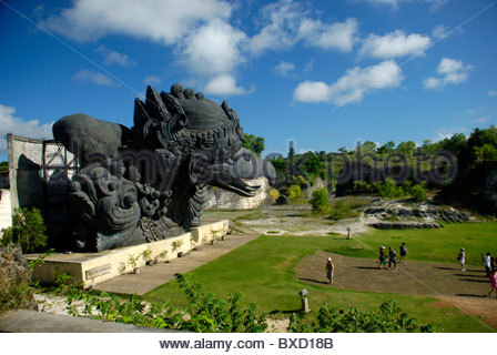 mythical Garuda bird with groups of tourists Garuda Wisnu Kencana Cultural Park Bukit Peninsula Bali Indonesia - Stock Photo