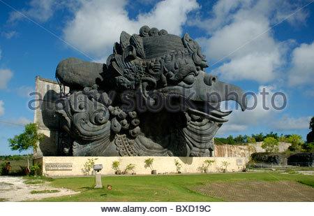 Large stone statue of the mythical Garuda bird Garuda Wisnu Kencana Cultural Park Bukit Peninsula Bali Indonesia - Stock Photo