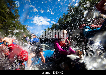 A group of adults whitewater rafting in Maine. - Stock Photo