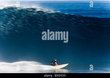 A surfer, captured in Speed Blur fashion at world famous Pipeline, on the north shore of Oahu, Hawaii. Stock Photo