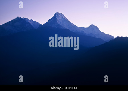Annapurna South and surrounds as seen at sunrise. - Stock Photo
