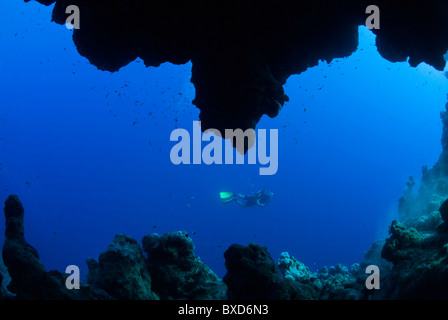 Scuba diver in the crack, The Bells, Dahab, Egypt, Red Sea - Stock Photo