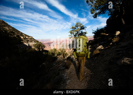 A female hiker hikes along the South Bass Trail in the Grand Canyon, Arizona. - Stock Photo