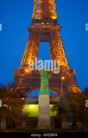 Paris, Tour Eiffel and Statue of Liberty at Night - Stock Photo