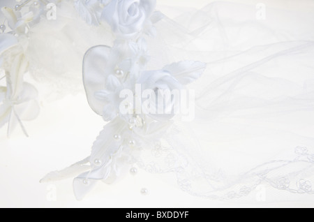 Detail of white wedding veil with headdress.Over white - Stock Photo