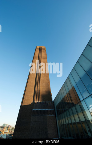 Brick Chimney Reflected in Glass at the Tate Modern, London, UK - Stock Photo