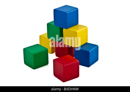 colorful wood building blocks stacked as pyramid. Isolated on white - Stock Photo