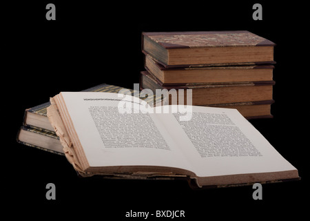 Old style vintage books, isolated on black - Stock Photo