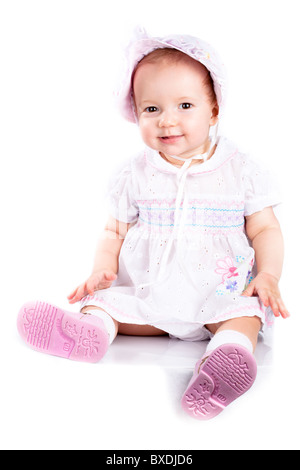 Baby in studio against a white background. - Stock Photo