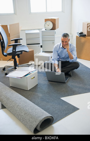 Business entrepreneur working in startup office - Stock Photo