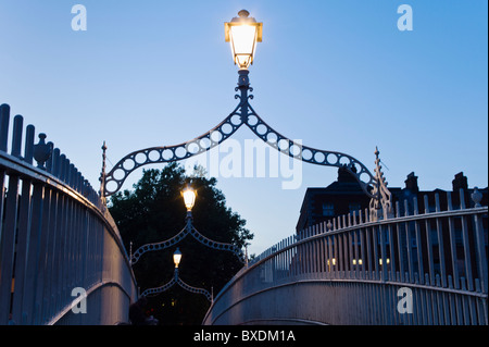 Lights on Ha'penny bridge in Dublin Ireland - Stock Photo