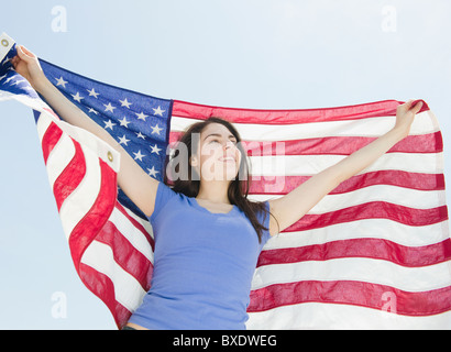 Woman holding American flag - Stock Photo