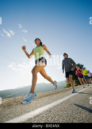 Runners on a road in Malibu - Stock Photo