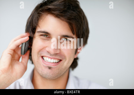 Handsome man talking on cell phone - Stock Photo