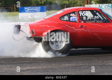 Racing car spinning wheels before race at Richmond Dragway in Sandston, Virginia. - Stock Photo